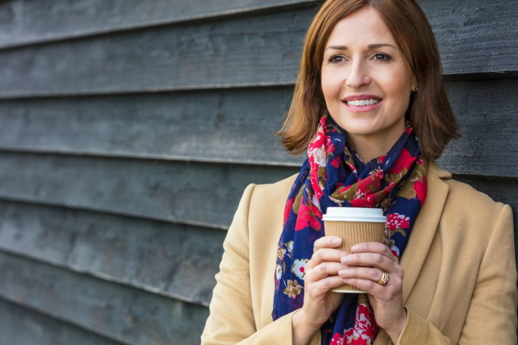 Attractive Business Women holding Coffee