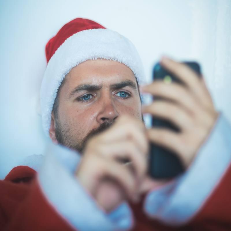 Christmas man using mobile phone
