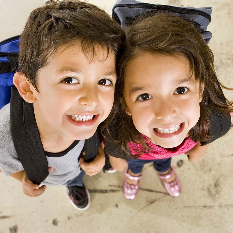 Little Boy and Girl with their Backpacks