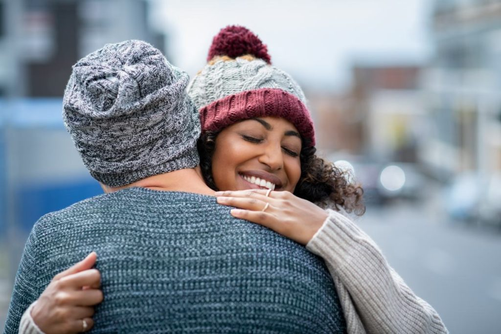 A couple giving each other a hug
