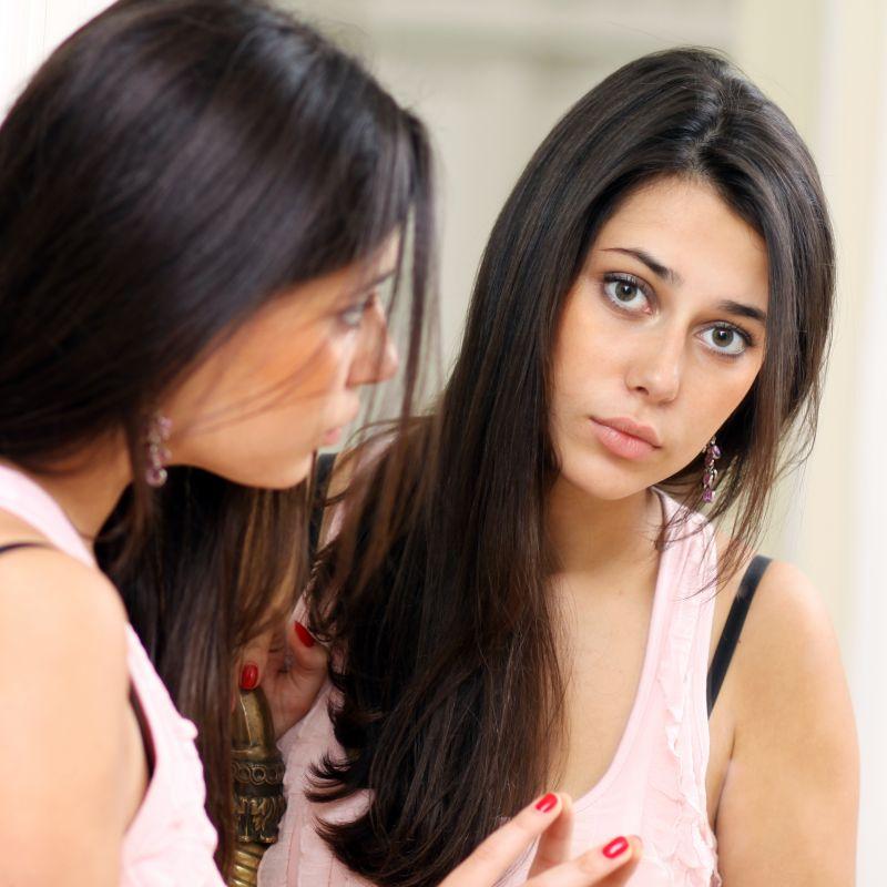 Women Looking Into Mirror
